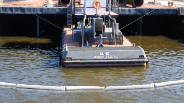 Boom-Skirted-Around barge
